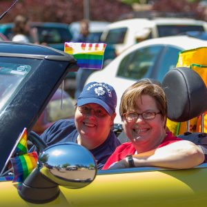 Dr. Jaime Harker (R) with wife Dixie Grimes before the inaugural Pride Parade in 2016