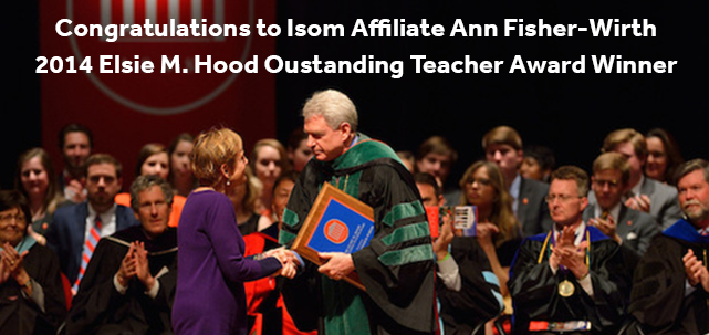 Ann Fisher-Wirth accepts the 2014 Elsie M. Hood Outstanding Teacher Award from Chancellor Daniel Jones